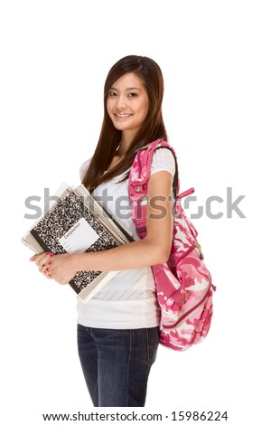 Friendly Asian High school girl student standing in jeans with backpack and holding notebooks and composition book - stock photo