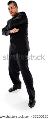 Friendly Asian man with short black hair in business formal outfit with arms folded - Isolated