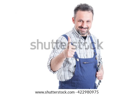 Friendly attractive mechanic in uniform showing thumb up or like gesture and smiling isolated on white - stock photo