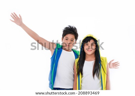 Friendly attractive young teenage siblings standing on white background - stock photo