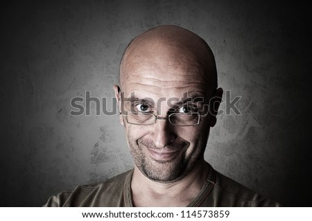 Friendly bald man smiles into the camera