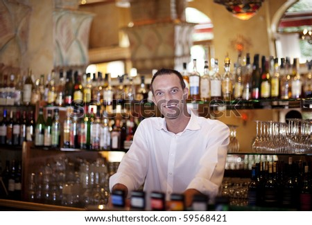 Friendly Bar Tender. Our very own Cocktail ready to serve you - stock photo