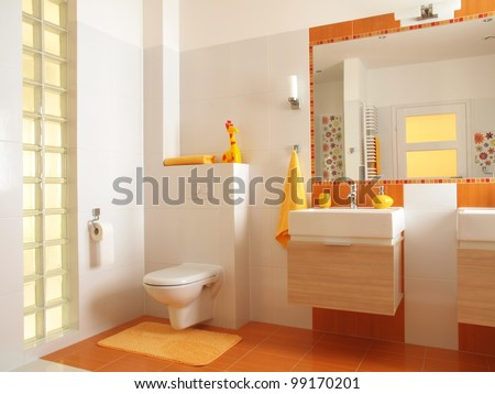 Friendly bathroom for children with orange tiles and flower decors, - stock photo