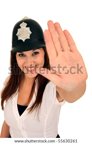 Friendly beautiful brunette police woman with hand out to stop