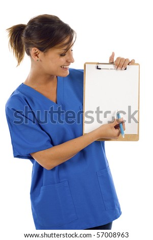 Friendly beautiful nurse pointing at a blank paper on the clipboard isolated over a white background - stock photo