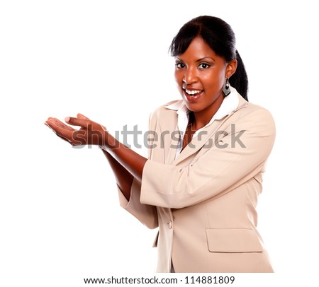 Friendly black woman looking at you with hands up against white background - stock photo