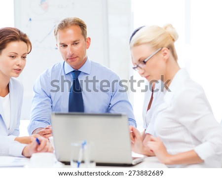 friendly business team having meeting in office - stock photo