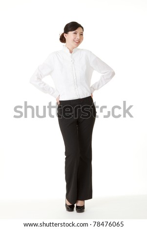 Friendly business woman of Asian smiling and looking at you, full length portrait in studio white background.