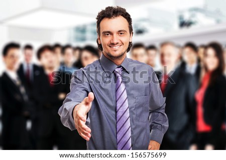 Friendly businessman giving his hand to seal a deal - stock photo