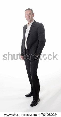 friendly businessman in front of white background, full length - stock photo