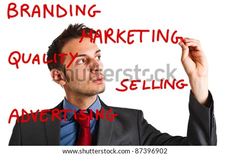 Friendly businessman writing marketing concepts on the screen - stock photo