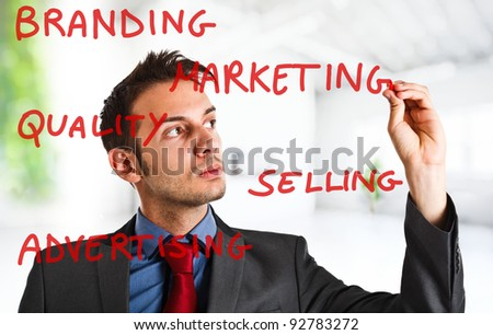 Friendly businessman writing on the screen - stock photo