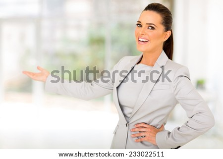 friendly businesswoman doing welcoming gesture - stock photo