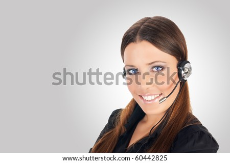 Friendly call service operator over grey background. - stock photo