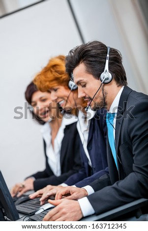 friendly callcenter agent operator with headset telephone support service