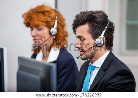 friendly callcenter agent operator with headset telephone support service  - stock photo