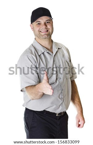 Friendly Car Mechanic ready to shake hands - stock photo