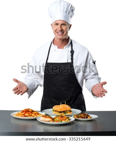 Friendly Caucasian Chef in uniform with arms open presenting different kinds of food - Isolated