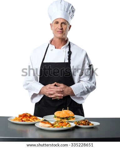Friendly Caucasian Chef in uniform with clasped hands standing behind a plateful of foods  - Isolated