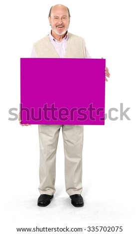 Friendly Caucasian elderly man with short grey hair in casual outfit holding large sign - Isolated - stock photo