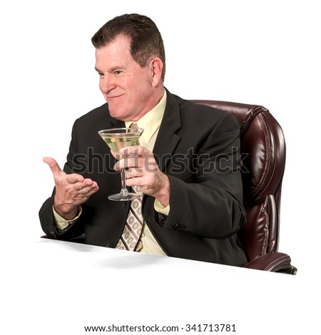 Friendly Caucasian elderly man with short medium brown hair in business formal outfit holding martini glass - Isolated - stock photo