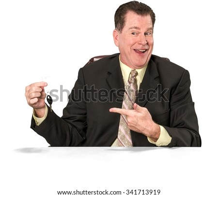 Friendly Caucasian elderly man with short medium brown hair in business formal outfit holding key - Isolated