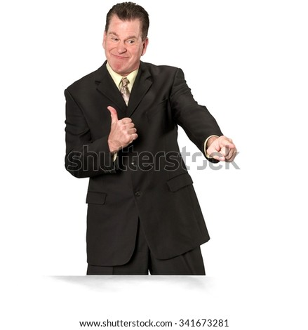 Friendly Caucasian elderly man with short medium brown hair in business formal outfit pointing using finger - Isolated
