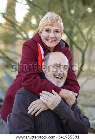 Friendly Caucasian elderly men with short red hair cuddling - stock photo