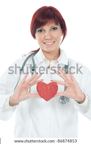 Friendly caucasian female cardiologist with a red wooden heart in her hands, isolated over white - stock photo