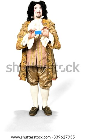 Friendly Caucasian man with medium black hair in costume holding business card - Isolated - stock photo