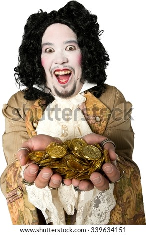 Friendly Caucasian man with medium black hair in costume holding coins - Isolated