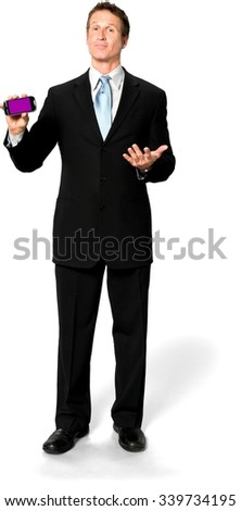 Friendly Caucasian man with short black hair in business formal outfit holding screen surface - Isolated - stock photo