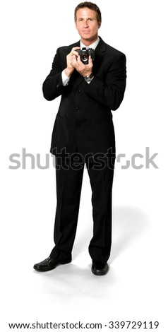 Friendly Caucasian man with short black hair in business formal outfit using camera - Isolated - stock photo