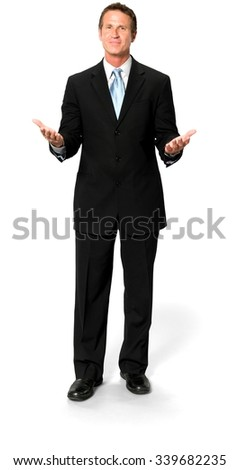 Friendly Caucasian man with short black hair in business formal outfit with hands open - Isolated - stock photo