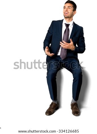 Friendly Caucasian man with short dark brown hair in business formal outfit talking with hands - Isolated