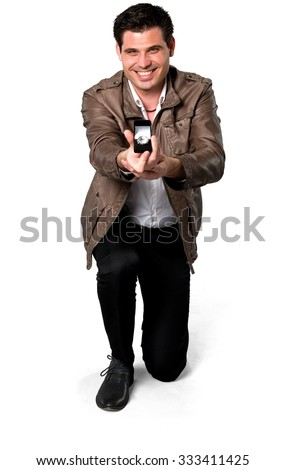 Friendly Caucasian man with short dark brown hair in casual outfit holding jewels - Isolated - stock photo