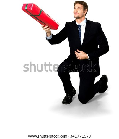 Friendly Caucasian man with short medium blond hair in business formal outfit holding wrapped gift - Isolated