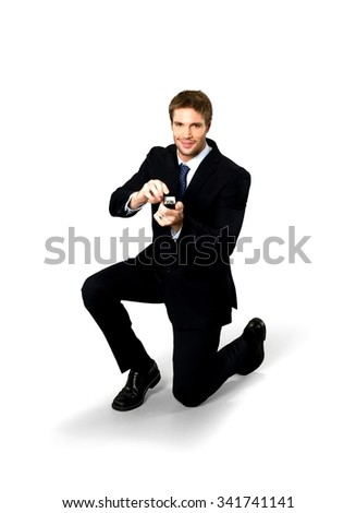 Friendly Caucasian man with short medium blond hair in business formal outfit using engagement ring - Isolated
