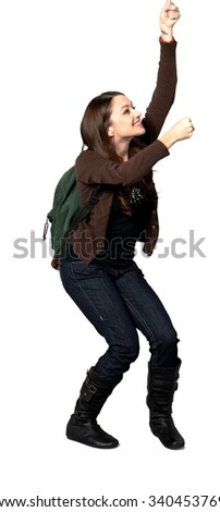 Friendly Caucasian young woman with long dark brown hair in casual outfit holding backpack - Isolated