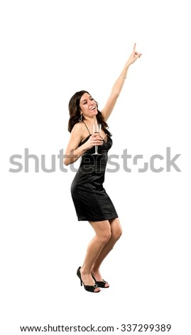 Friendly Caucasian young woman with long dark brown hair in evening outfit holding champagne glass - Isolated