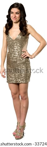 Friendly Caucasian young woman with long dark brown hair in evening outfit with hands on hips - Isolated