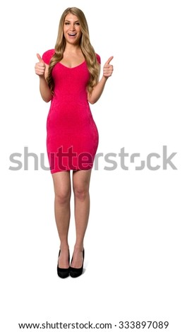 Friendly Caucasian young woman with long light blond hair in evening outfit cheering - Isolated - stock photo