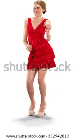 Friendly Caucasian young woman with medium blond hair in evening outfit holding champagne glass while dancing - Isolated - stock photo