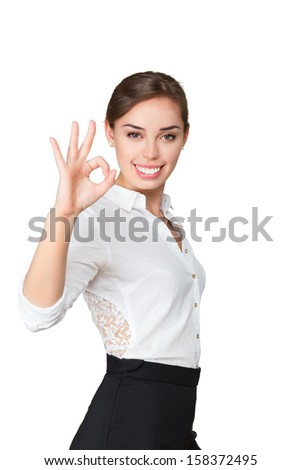 Friendly cheerful smiling business woman showing OK gesture isolated on white background - stock photo