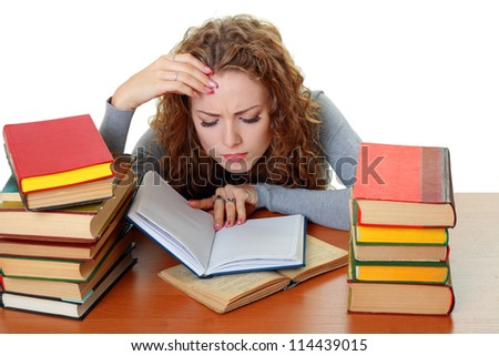 Friendly College student girl with books at the desk isolated - stock photo