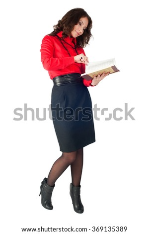 Friendly confident businesswoman writing in her organizer. Isolated over white background.