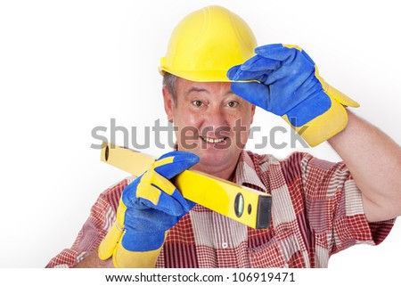 Friendly construction worker with a spirit level and safety gloves