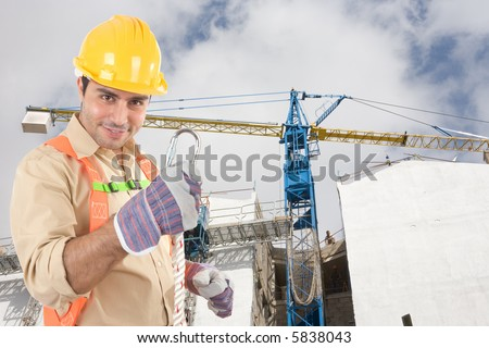 Friendly construction worker with safety attachment