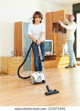 friendly couple  doing housework together in home