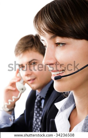 Friendly customer representatives smiling during a telephone conversation - stock photo
